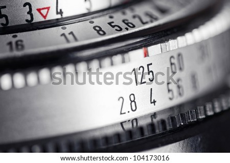 The lens, focus and exposure controls of a simple classic 35mm film camera. - stock photo