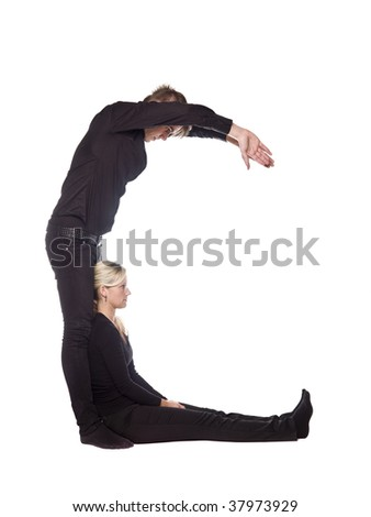 The letter 'C' formed by people dressed in black - stock photo