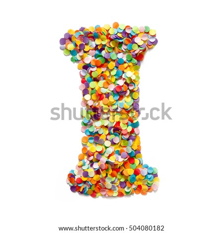 The letter I is laid out colored confetti. White background.