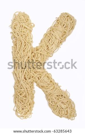 The letter K in spaghetti - stock photo