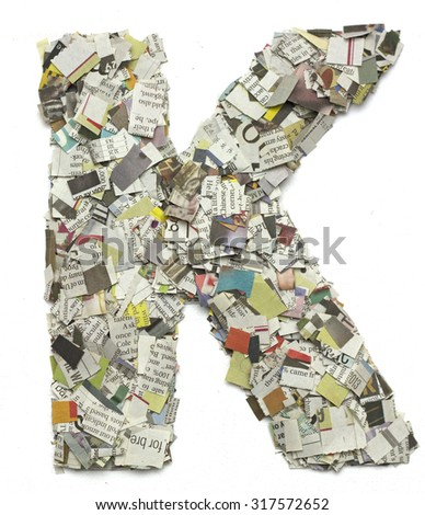The letter K  made from newspaper confetti - stock photo