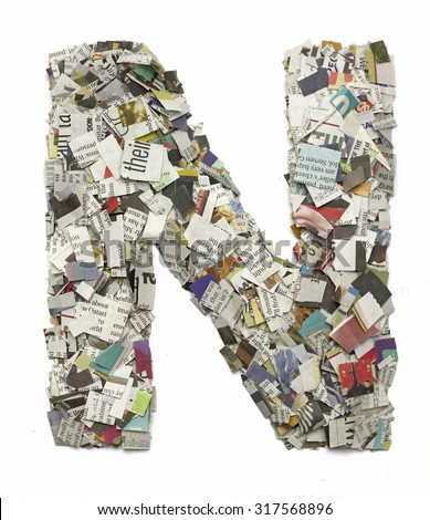 The letter N made from newspaper confetti - stock photo