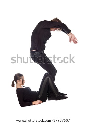 The letter 'S' formed by people dressed in black - stock photo