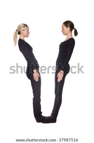 The letter 'V' formed by people dressed in black - stock photo