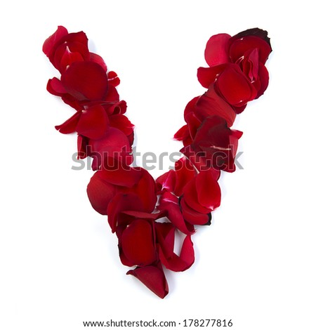 The letter V in love is written with rose petals. White background. - stock photo