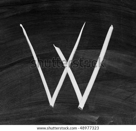 "The letter ""W"" written with white chalk on a blackboard gray"