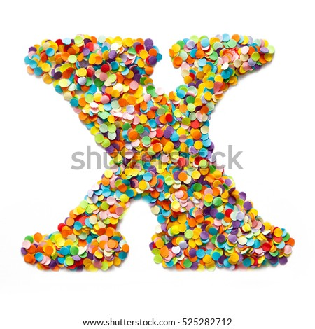 The letter X is laid out colored confetti. White background.