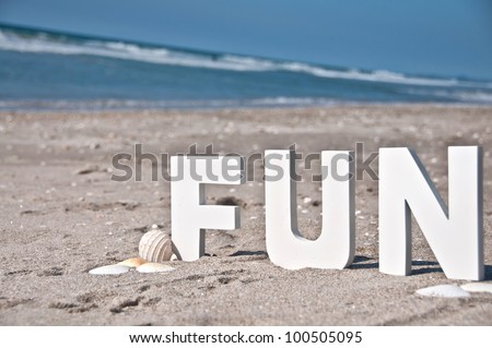 the letters and word fun at the beach block letters sitting in the sand