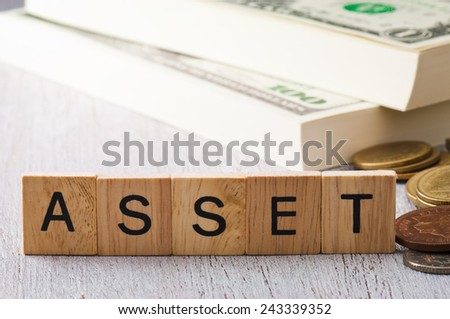 The letters ASSET on white wood business concept - stock photo