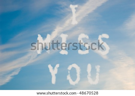 The letters I miss you written with cloud letters. - stock photo