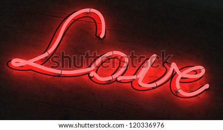 The letters LOVE lighted up in red neon colors - stock photo