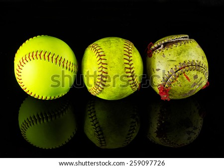 The life cycle of the softball. Three softballs on a different stage of use - stock photo