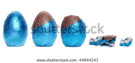 The lifecycle in stages of a Blue Foil covered chocolate easter egg isolated against white background.
