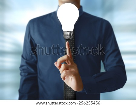 the light bulb in your hand - stock photo