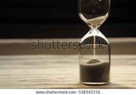 The light, sandglass and its shadow (very shallow depth of focus)