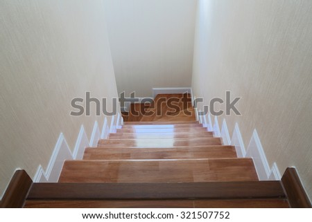 The light that shines through the window of a wooden staircase - stock photo