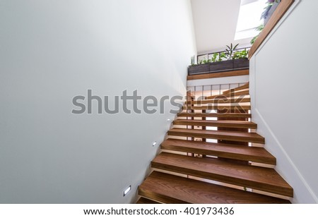 The light that shines through the window of wooden staircase - stock photo