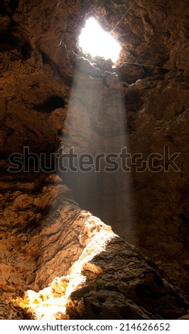 the  light through hole in the cave - stock photo