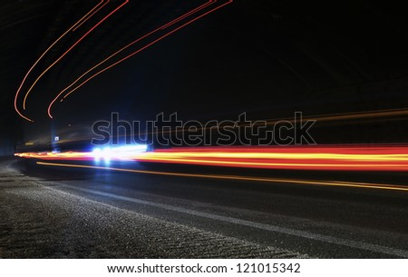 The light trails. Art image . Long exposure photo taken in a tunnel - stock photo