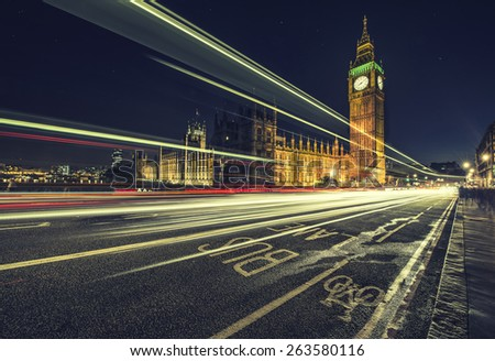 The light trails of a London bus - stock photo