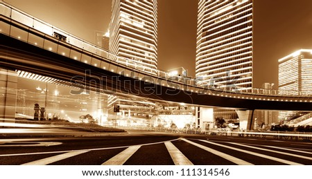 the light trails on the modern building background in china - stock photo
