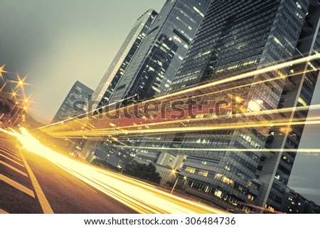 the light trails on the modern building background in city - stock photo