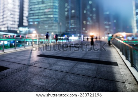 the light trails on the modern building background in shanghai chin - stock photo