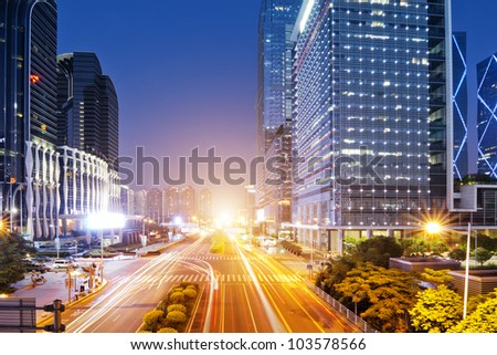 the light trails on the modern building background in shenzhen  china - stock photo