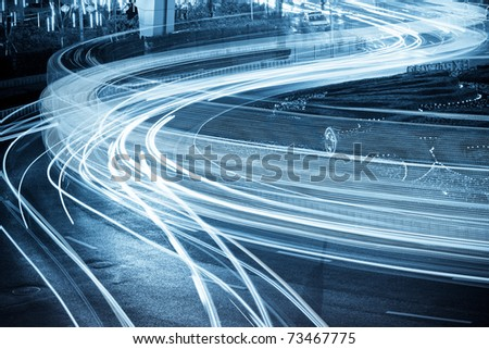 the light trails on the steet in shanghai china. - stock photo