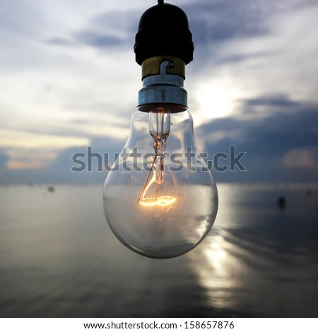 the lightbulb on beautiful sky background - stock photo