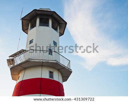 the lighthouse and beautiful cloud shape with close up style.   - stock photo