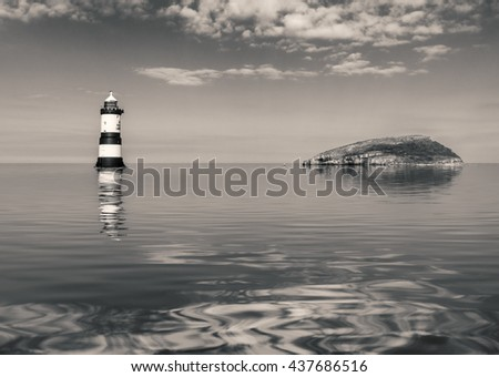 The Lighthouse at Puffin island in Anglesey North Wales on a calm day - stock photo