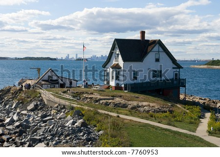 The lighthouse keeper's residence on an island in landscape orientation - stock photo