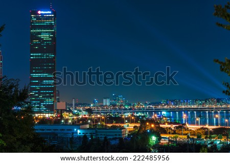 The lights of Seoul come up as night comes on. - stock photo
