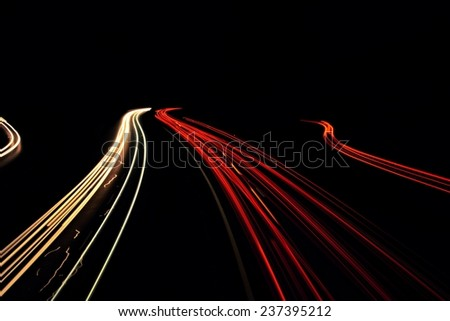 The lights of the cars coming down the highway at night