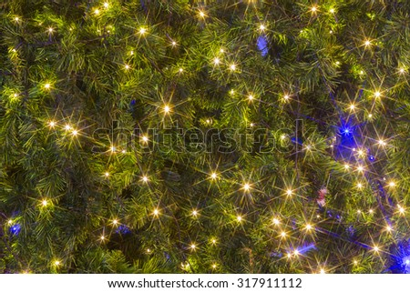 The lights on the Christmas tree decoration background - stock photo