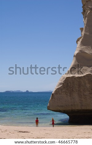The limestone cliffs of Cathedral Cove on the Coromandel Peninsular, New Zealand - stock photo