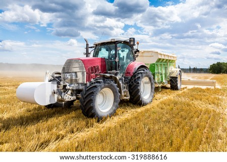 The liming action on the large wheat field - stock photo