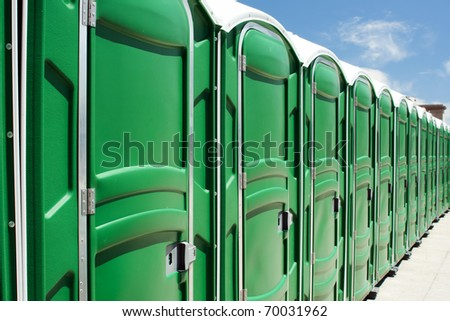The line of portable toilets - stock photo
