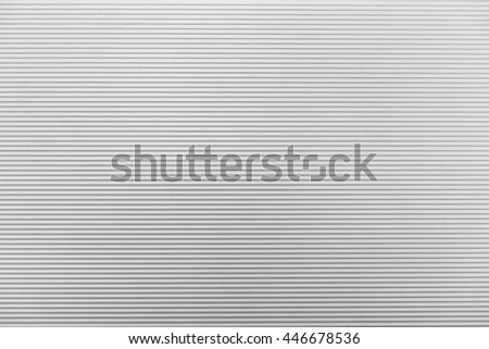 The line texture of the white shutter door of the factory building - stock photo