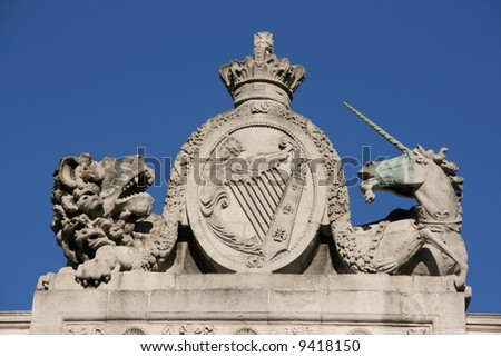 The Lion and The Unicorn - time-honoured symbols of the United Kingdom. The lion stands for England and the unicorn for Scotland. In the middle is national Irish Coat of Arms. - stock photo