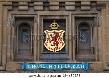 The Lion Rampant crest above the main entrance of Edinburgh Castle in Scotland. - stock photo