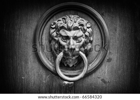 The lion's head as a doorknocker black and white - stock photo