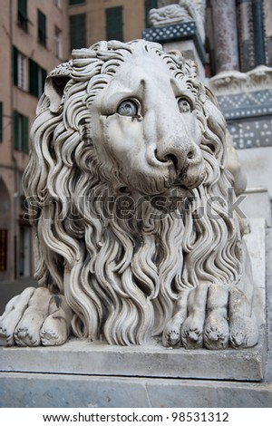 The lion statue in front of the Genoa Duomo