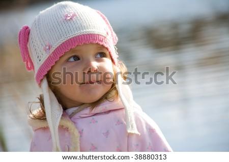 The little beautiful girl smiles - stock photo