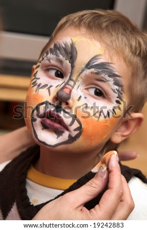 The little boy and a cheerful make-up - stock photo