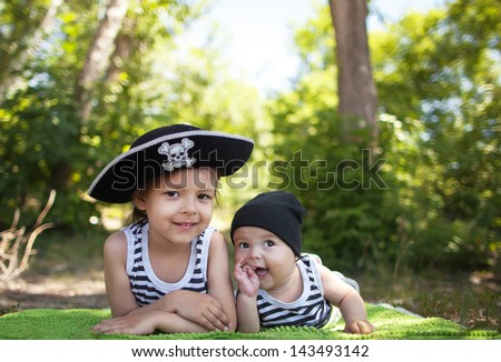 The little boy and girl in pirate costume - stock photo