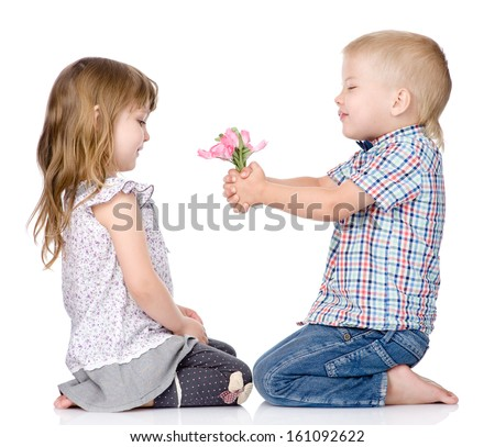 The little boy gives to the girl a flower. isolated on white background - stock photo