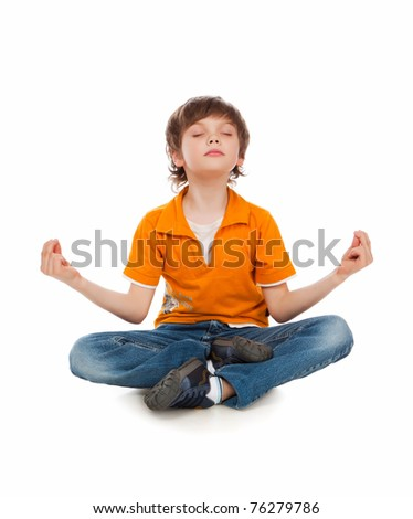 The little boy in a lotus pose meditates. Yoga