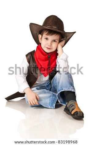 The little boy in a suit of the cowboy on a white background - stock photo